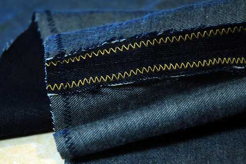The inside of the leg on a pair of jeans. The SA is the dark narrow stretch of fabric next to the seam. It has been zig-zagged to keep it from fraying